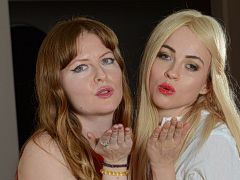 Two girls blowing kisses